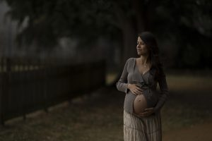 outdoor maternity portrait in a park with muted colours, location pregnancy shoot, london pregnancy photographer