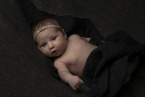newborn girl portrait on grey background